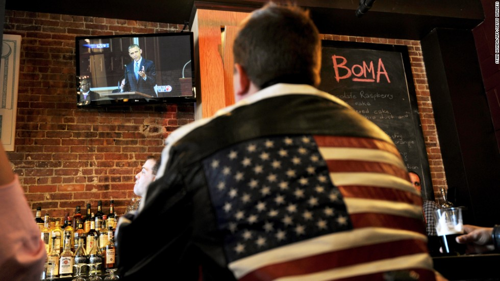 A man at a Boston restaurant watches Obama speak on television on April 18, 2013.