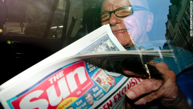(FILE) Rupert Murdoch holds a copy of 'The Sun on Sunday' newspaper on February 26, 2012.
