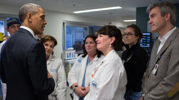 Obama talks with staff members at Massachusetts General Hospital while visiting injured patients on April 18, 2013.
