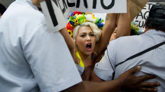 (File photo) Topless activists of the women's rights group Femen in Rio de Janeiro on February 8, 2013.