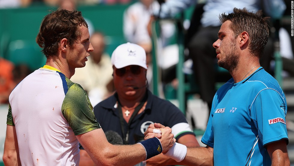 Andy Murray, left, crashed out with a straight-sets defeat by Stanislas Wawrinka which means the British star will lose the world No. 2 ranking to the Swiss 13th seed's compatriot Roger Federer next week.
