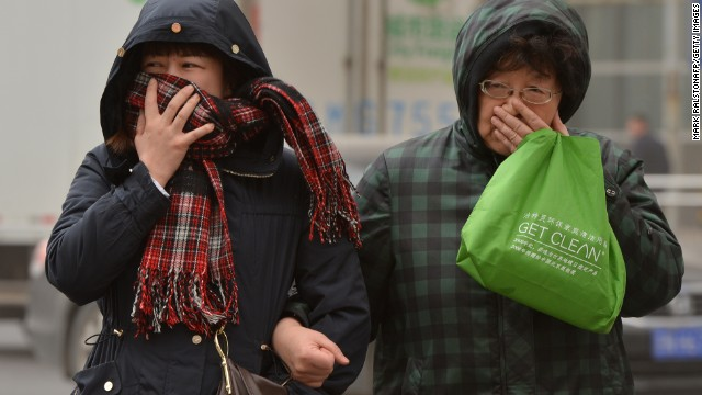 Chinese women try to cover their noses as Beijing is hit by a sandstorm as well as air quality worse than the highest classification of 'hazardous' on February 28, 2013. Beijing residents were urged to stay indoors on February 28 as pollution levels soared before a sandstorm brought further misery to China's capital.