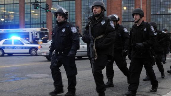 Officers patrol Watertown on Friday.