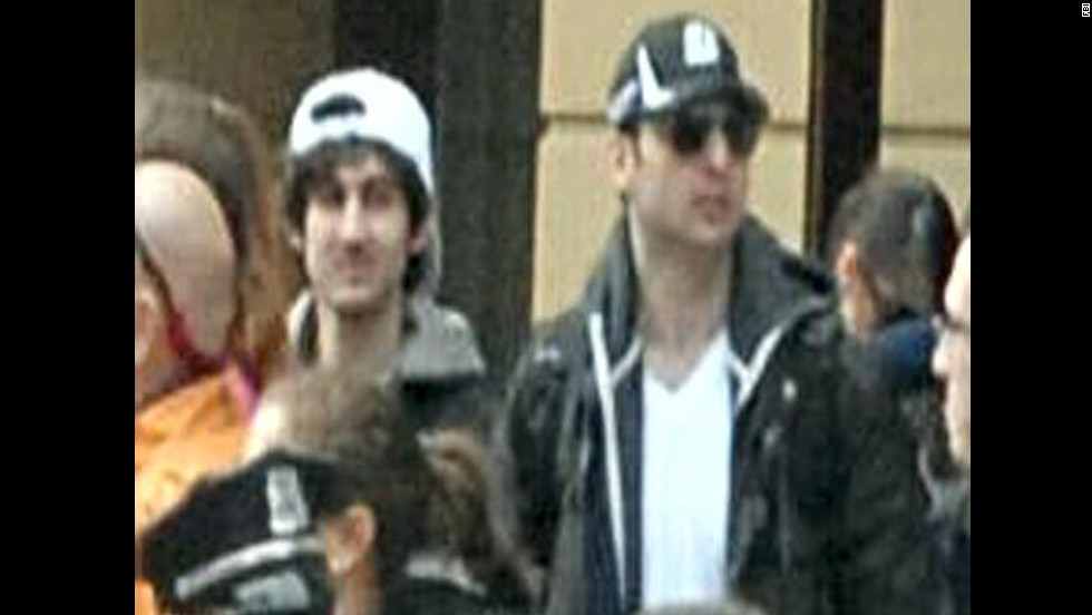"The FBI later identified the suspects as <a href=""http://www.cnn.com/2013/04/19/us/gallery/boston-suspect-2/index.html"">Dzhokhar Tsarnaev</a>, left, and his brother <a href=""http://www.cnn.com/2013/04/19/us/gallery/boxer-suspect-1/index.html"">Tamerlan Tsarnaev</a>."
