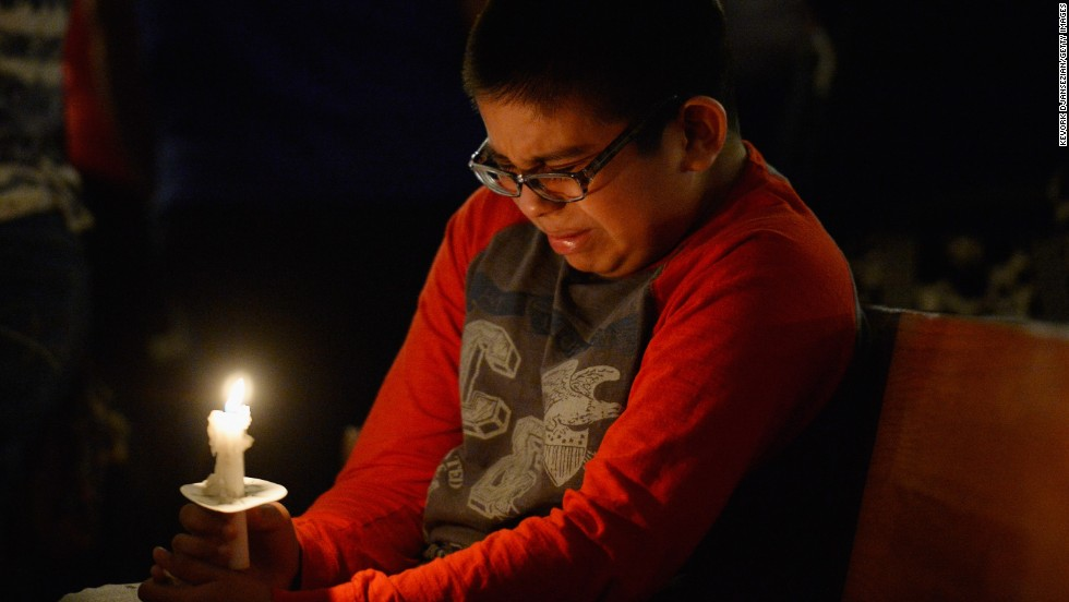 Eric Garcia, 12, cries during a candlelight vigil in West, Texas, honoring the victims of the explosion on April 18. More than 200 people were injured and 50 homes destroyed in the small town.