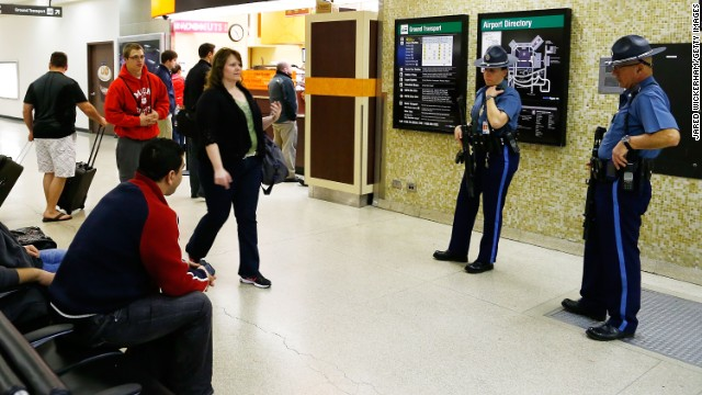 Passengers make their way earlier this week through Boston's Logan International Airport, where security has been heightened.