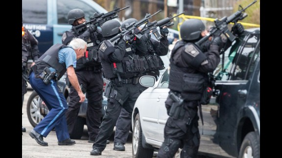 SWAT teams gather at the intersection of Nichols and Melendy avenues in Watertown while searching for the remaining suspect on Friday.