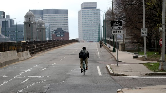 A lone bicyclist makes his way across the Longfellow Bridge.