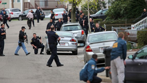 Police continue the ongoing manhunt for the second suspect on Williow Avenue in Watertown on Friday.