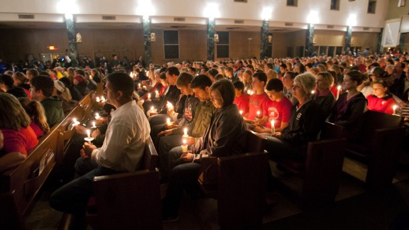 A candlelight vigil is held at St. Mary
