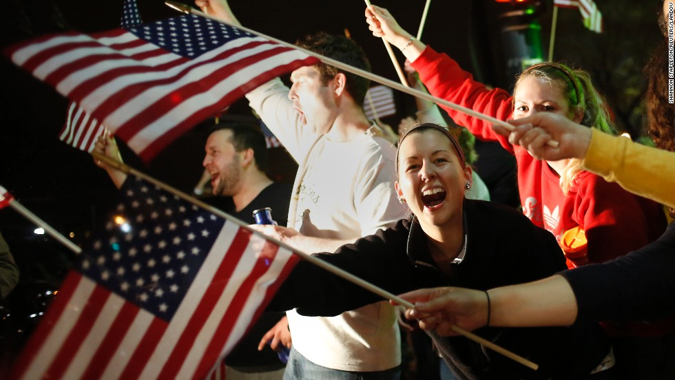 People wave U.S. flags in Watertown after it was announced that Tsarnaev had been captured.