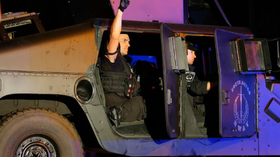 A member of the North Metro SWAT team pumps his fist while leaving the scene near Franklin Street on April 19.