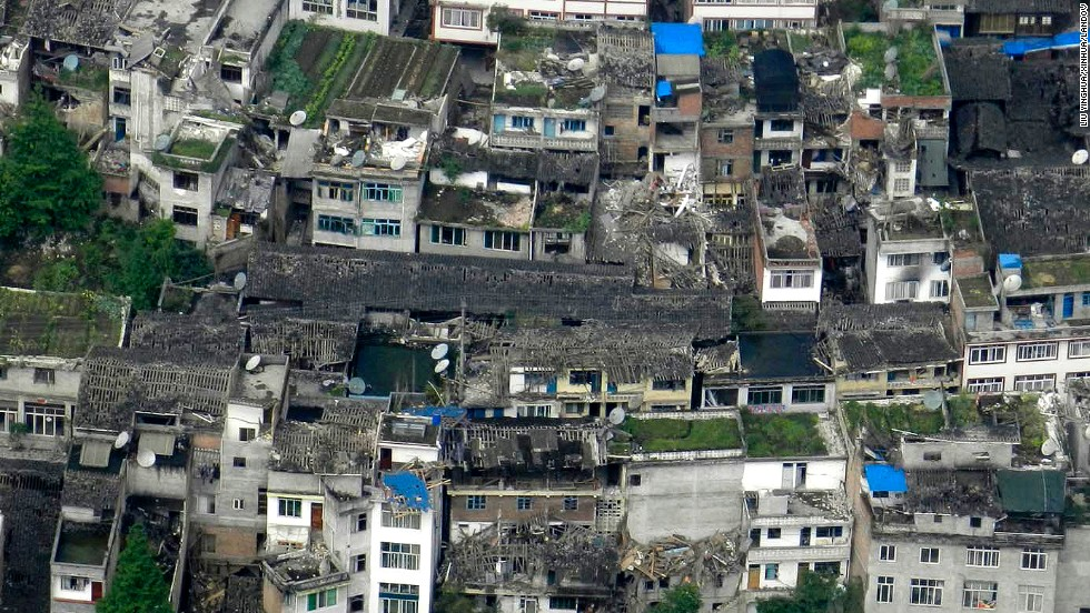 This photo taken on a helicopter shows the quake-destroyed houses in Taiping Town in Ya'an City on Saturday.
