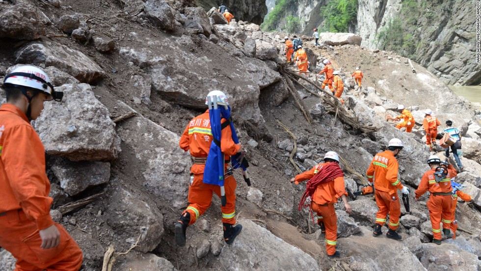 Rescuers head for Baosheng township on Saturday.