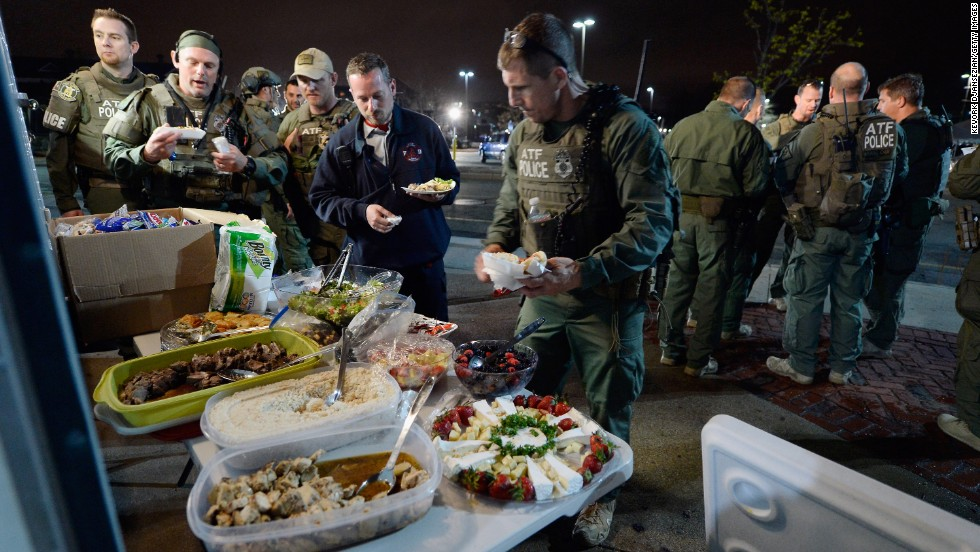 Officers from the Department of  Alcohol, Tobacco, Firearms and Explosives relax Friday  after the capture in Watertown, Massachusetts.