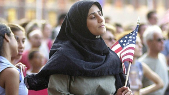 A Muslim woman attends an interfaith vigil for September 11 victims in Boston last fall.