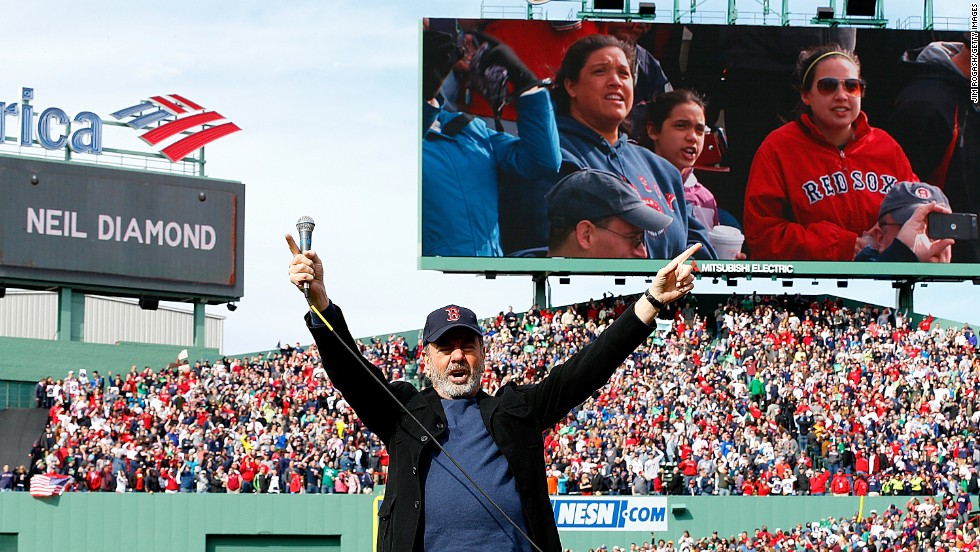 "Neil Diamond sings ""Sweet Caroline,"" a song traditionally played at Boston Red Sox home games, during a game against the Kansas City Royals on April 20."