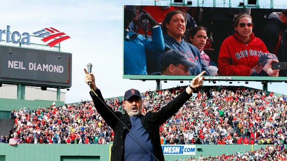 """Neil Diamond sings """"Sweet Caroline"""" during Saturday's game between the Kansas City Royals and Boston Red Sox in Fenway Park."""