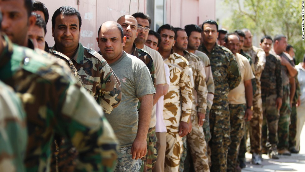Policemen of the Ministry of Justice wait in line to vote during provincial elections at al-Rusafa Prison in Baghdad on Saturday.