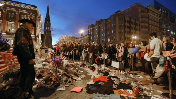 People gather at a makeshift memorial in Boston on April 20, 2013.
