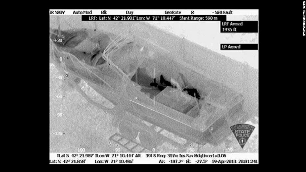 The heat signature clearly shows the suspect's feet and the rest of his body behind the boat console at 8:01 p.m., minutes before he surrendered.