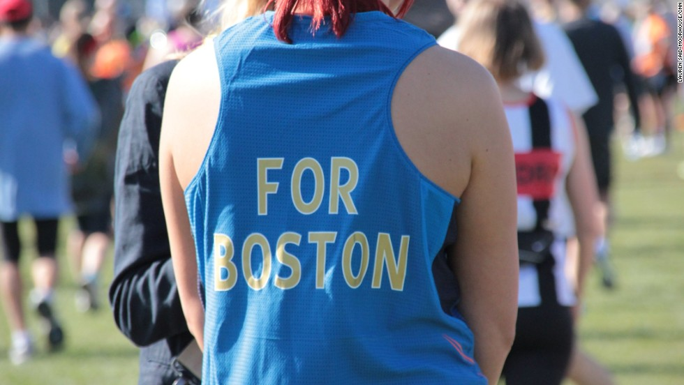 Thousands of London Marathon runners paid tribute to Boston this morning wearing black ribbons and observing a 30-second silence on the start line. Here one athlete customized her shirt with the words 'For Boston' on the back.