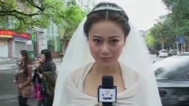 Bride covers quake in wedding dress