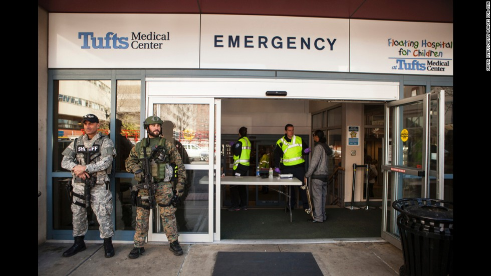 SWAT team members guard the Tufts entrance.