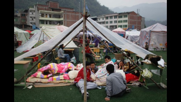 Families rest at an emergency relief center in Ya