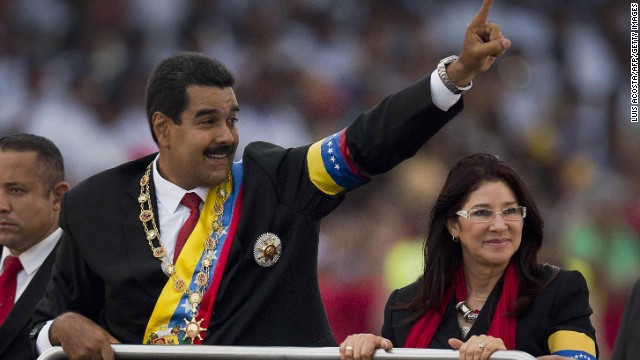 Venezuelan President Nicolas Maduro waves to the crowd during a motorcade after his installation in Caracas on April 19, 2013. AFP PHOTO/Luis Acosta (Photo credit should read LUIS ACOSTA/AFP/Getty Images)