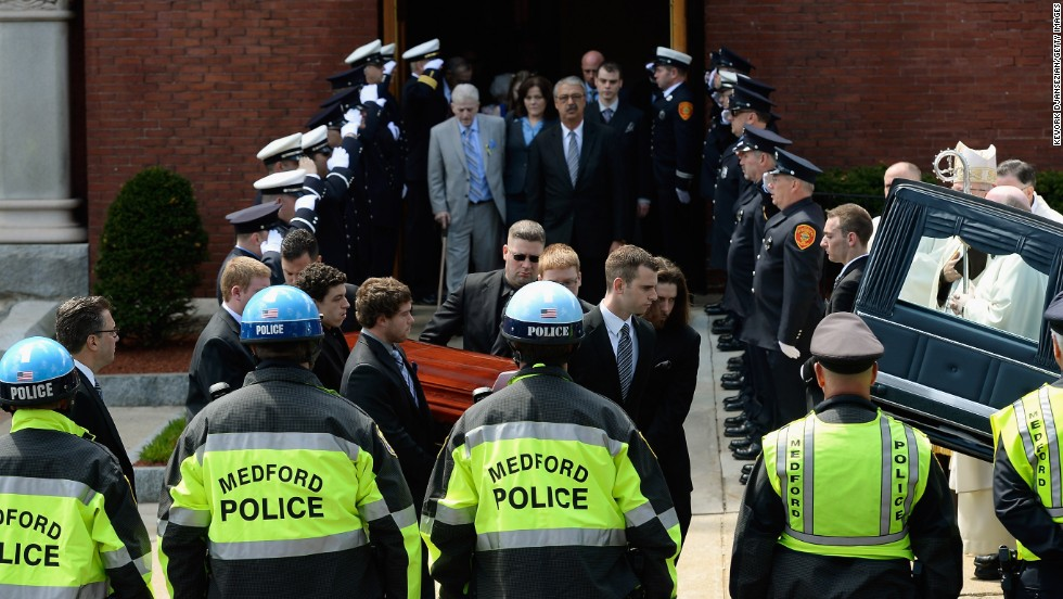Pallbearers carry Campbell's casket after a funeral service in Medford, Massachusetts, on April 22, 2013.