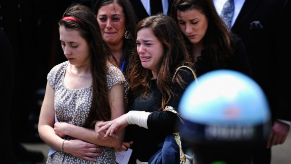 Mourners walk out of St. Joseph Catholic Church after Campbell