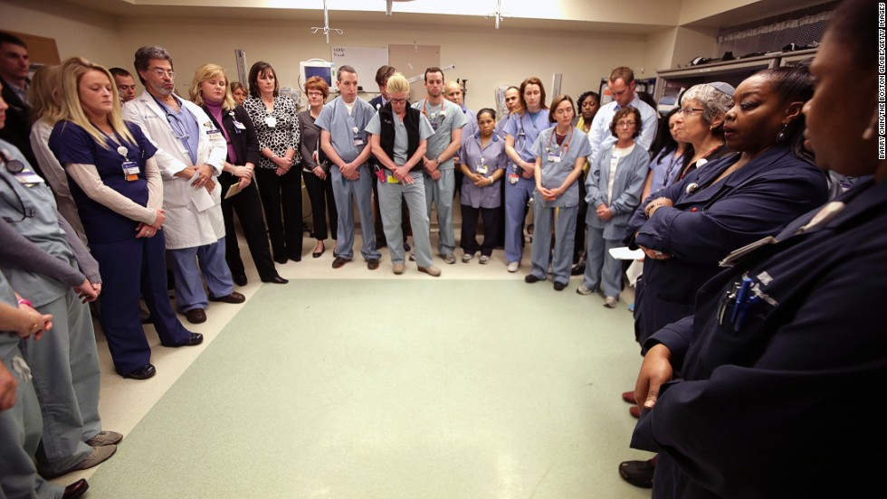 Staff members of the Beth Israel Deaconess Medical Center gather inside a trauma room to observe a moment of silence on April 22, 2013.