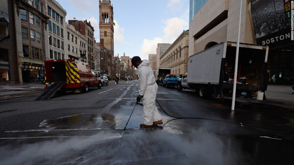 A cleaner power washes Boylston Street near the blast site after the FBI handed the area back to the city of Boston on Monday, April 22, following the week-long investigation.