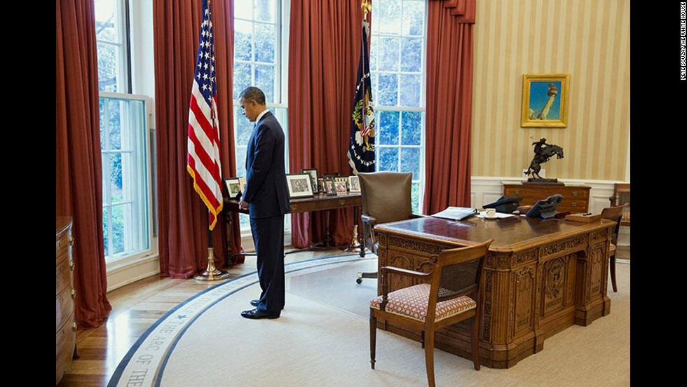 President Barack Obama observes a moment of silence in the White House Oval Office on April 22, 2013.