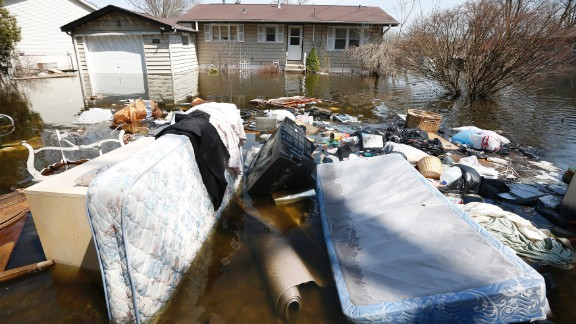 Household items are submerged in floodwaters in front of a house in Fox Lake, Illinois, on Monday, April 22. Steady rains are expected Tuesday, April 23, in several Midwestern states already facing severe flooding. Have you been affected by the flooding? Share your images with CNN iReport.
