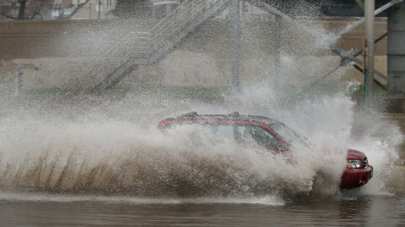 A motorist barrels through a flooded section of the Kennedy Expressway on Thursday, April 18, in Chicago.