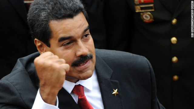 Venezuelan President Nicolas Maduro clenches his fist as he enters to the National Assembly before the Presidential inauguration in Caracas on April 19, 2013.
