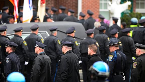 Law enforcement officials enter St. Patrick
