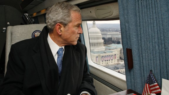 George W. Bush looks out over Washington as his helicopter departs for Andrews Air Force Base after the inauguration ceremonies for President Barack Obama in January 2009.