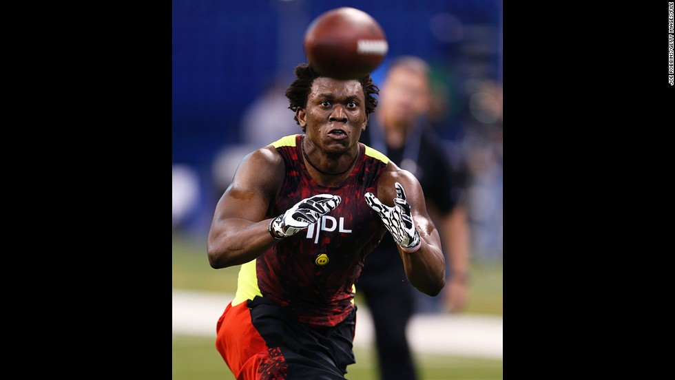 Ziggy Ansah of Brigham Young University works out during the 2013 NFL Combine on February 25 in Indianapolis.