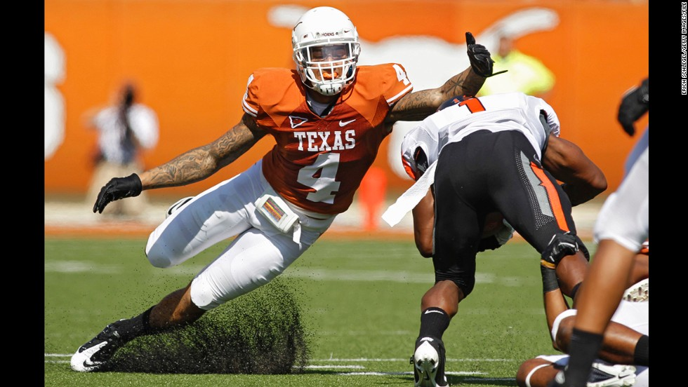 Safety Kenny Vaccaro of the Texas Longhorns attempts to tackle running back Joseph Randall of the Oklahoma State Cowboys on October 15, 2011, at Darrell K. Royal-Texas Memorial Stadium in Austin, Texas.