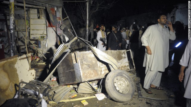 Pakistani security officials examine the site of a suicide bomb attack in Quetta on Tuesday.