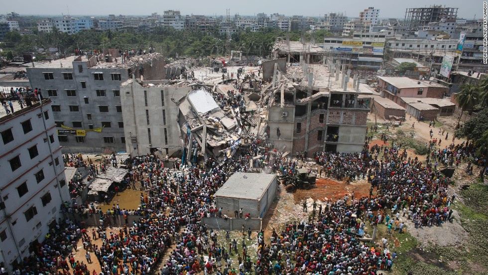 Crowds gather around the collapsed building on April 24.