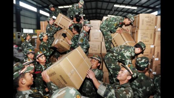 Rescue workers unload medicine in Ya