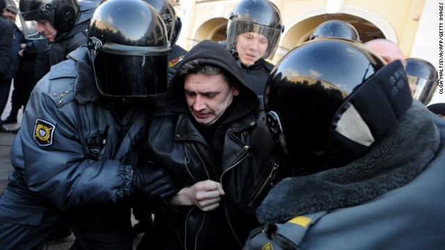 Riot police officers detain an activist in central St. Petersburg on March 31, 2013, during an unauthorized protest rally.