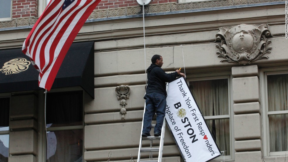 "A man removes a sign hanging from the Lennox Hotel along Boylston Street after the street reopened to the public for the first time since the Boston Marathon bombings in Boston on Wednesday, April 24. The city is trying to return to normal less than a week after two bombs exploded near the finish line of the Boston Marathon, shocking the nation and leaving the city on edge. <a href=""http://www.cnn.com/SPECIALS/us/boston-bombings-galleries/index.html"">See all photography relating to the Boston bombings.</a>"