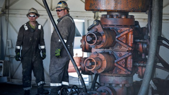 Workers chat at Consol Energy horizontal gas drilling rig, fracking the Marcellus shale near Waynesburg, Pennsylvania.