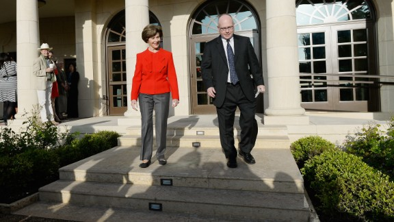 Former first lady Laura Bush and Alan Lowe, director of the George W. Bush Presidential Library, arrive to speak to media during a tour of the center.