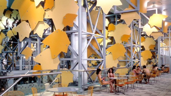 The spa facade is ornamented with giant green and yellow aluminum tree leaves.